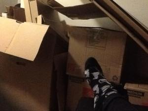 These are SOME of the unpacked boxes...and my tired feet in my favorite gray cat socks.